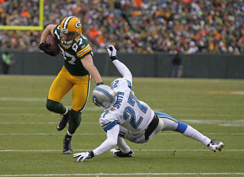 Jordy Nelson with the tough stiff arm on Lions CB Alphonso Smith