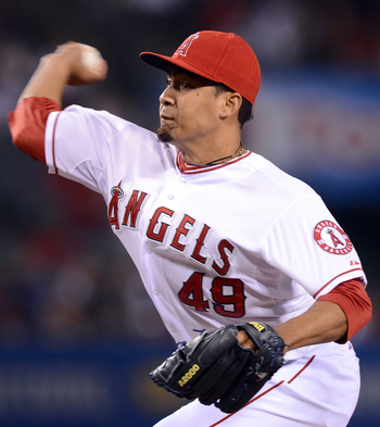 ANAHEIM, CA - MAY 05:  Ernesto Frieri #49 of the Los Angeles Angels pitches in the ninth inning against the Toronto Blue Jays at Angel Stadium of Anaheim on May 5, 2012 in Anaheim, California.  The Angels won 6-2.    (Photo by Harry How/Getty Images)