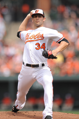 BALTIMORE, MD - MAY 13: Jake Arrieta #34 of the Baltimore Orioles pitches during a baseball game against the Tampa Bay Rays at Oriole Park at Camden Yards on May 13, 2012 in Baltimore, Maryland. (Photo by Mitchell Layton/Getty Images)