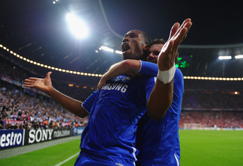 MUNICH, GERMANY - MAY 19:  Didier Drogba of Chelsea celebrates with team mate Juan Mata after scoring his team's first goal during UEFA Champions League Final between FC Bayern Muenchen and Chelsea at the Fussball Arena München on May 19, 2012 in Munich,