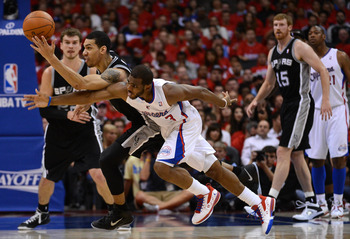 San Antonio's Danny Green and LA's Chris Paul fight for a loose ball.
