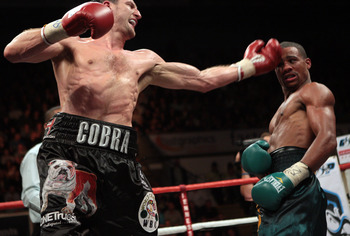 Carl Froch (left) hitting Andre Direll (right)