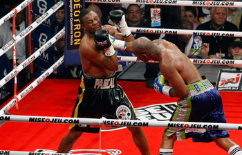 Jean Pascal (left) getting nailed by Bernard Hopkins (right)