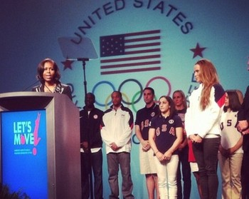 Michelle Obama speaks with Wieber in blue USA jersey and white pants