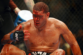 May 26, 2012; Las Vegas, NV, USA; Blood drips down the forehead of Antonio Silva during his fight against Cain Velasquez during UFC 146 at the MGM Grand Garden event center. Mandatory Credit: Ron Chenoy-US PRESSWIRE