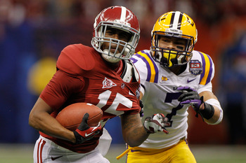 NEW ORLEANS, LA - JANUARY 09:  Darius Hanks #15 of the Alabama Crimson Tide runs as Tyrann Mathieu #7 of the Louisiana State University Tigers pulls his jersey from behind during the 2012 Allstate BCS National Championship Game at Mercedes-Benz Superdome