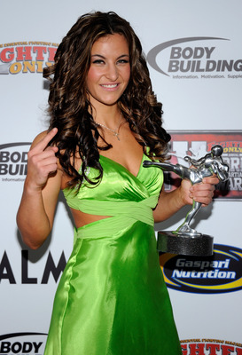 LAS VEGAS, NV - NOVEMBER 30:  Mixed martial artist Miesha Tate holds the Female Fighter of the Year award at the Fighters Only World Mixed Martial Arts Awards 2011 at The Pearl concert theater at the Palms Casino Resort November 30, 2011 in Las Vegas, Nev