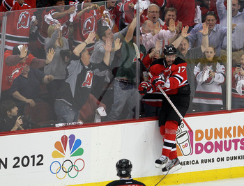 NEWARK, NJ - MAY 25:  Ilya Kovalchuk #17 of the New Jersey Devils celebrates after scoring a goal in the first period against the New York Rangers in Game Six of the Eastern Conference Final during the 2012 NHL Stanley Cup Playoffs at the Prudential Cente