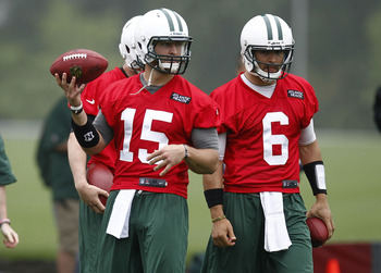Jets QBs Tim Tebow (15) and Mark Sanchez