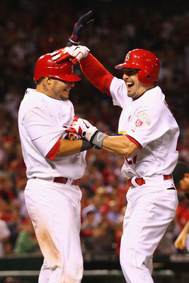 Yadier Molina (Left) and Tyler Greene (Right)