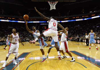 Bobcats big man Bismack Biyombo tries to block a Clipper shot.