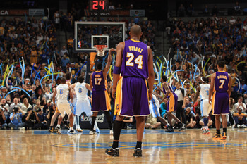 DENVER, CO - MAY 06:  Kobe Bryant #24 of the Los Angeles Lakers watches as the Denver Nuggets fans distract Andrew Bynum #17 of the Los Angeles Lakers during a free throw in Game Four of the Western Conference Quarterfinals in the 2012 NBA Playoffs at Pep