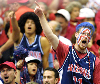 25 March 2001:  Arizona fans cheer for the Wildcats during the NCAA Midwest Regional Final at the Alamodome in San Antonio, Texas.  The Wildcats defeated the Fighting Illini 87-81.  DIGITAL IMAGE. Mandatory Credit: Ronald Martinez/ALLSPORT