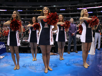 LOS ANGELES, CA - MARCH 10:  The Arizona Wildcats cheerleaders stand during the national anthem before the Wildcats take on the Colorado Buffaloes in the championship game of the Pacific Life Pac-12 basketball tournament at Staples Center on March 10, 201