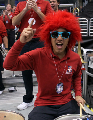 LOS ANGELES, CA - MARCH 08:  A member of the Arizona Wildcats band performs before the Wildcats take on the UCLA Bruins in the quarterfinals of the 2012 Pacific Life Pac-12 basketball tournament at Staples Center on March 8, 2012 in Los Angeles, Californi