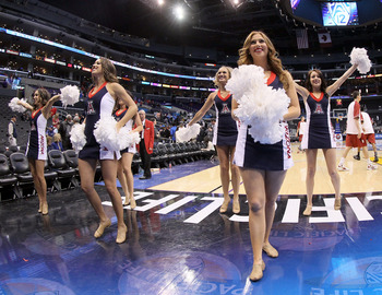LOS ANGELES, CA - MARCH 08:  Arizona Wildcats cheerleaders perform after the Wildcats 66-58 victory against the UCLA Bruins during the quarterfinals of the 2012 Pacific Life Pac-12 basketball tournament at Staples Center on March 8, 2012 in Los Angeles, C