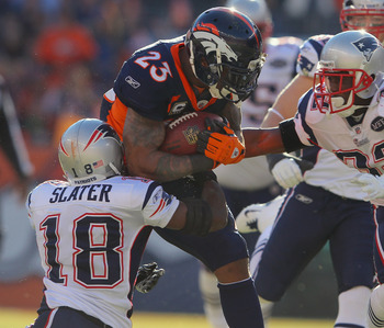 Slater bringing down Broncos running back Willis McGahee