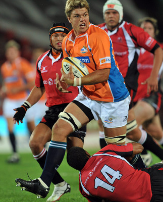 JOHANNESBURG, SOUTH AFRICA - FABRUARY 13:   Juan Smith of the Cheetahs is tackled by Ashwin Willemse of the Lions during the round one Super 14 match between the Lions and the Cheetahs on February 13, 2009 at Coca-Cola Park in Johannesburg, South Africa.