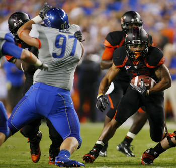 Chase Baker (No. 97) recorded 100 tackles and 6.5 sacks during his four-year career at Boise State.