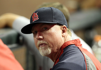 Mark McGwire isn't bashing long balls anymore, but he's teaching Cardinals batters how to these days.l.