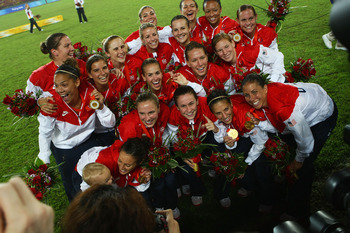 BEIJING - AUGUST 21:  The United States team poses for the cameras with their Gold medals for the Women's Football on Day 13 of the Beijing 2008 Olympic Games on August 21, 2008 at Worker's Stadium in Beijing, China.  (Photo by Lars Baron/Getty Images)