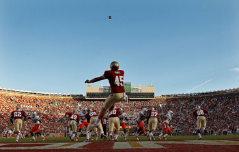 TALLAHASSEE, FL - NOVEMBER 12: Shawn Powell #45 of the Florida State Seminoles punts during a game against the Miami Hurricanes at Doak Campbell Stadium on November 12, 2011 in Tallahassee, Florida.  (Photo by Mike Ehrmann/Getty Images)