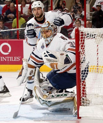 Backstopped by a suddenly hot journeyman goaltender, Dwayne Roloson, the Oilers came out of the weeds in the Western Conference to reach the Stanley Cup final, where they extended the Hurricanes to seven games. The Oilers, who hadn't made the playoffs the previous season or been beyond the first round since 1998, haven't been back to the postseason since their surprising run. Photographed by: David E. Klutho/SI