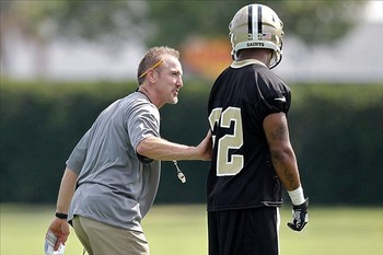 Steve Spagnuolo works with Johnny Patrick (photo courtesy of USA Today).