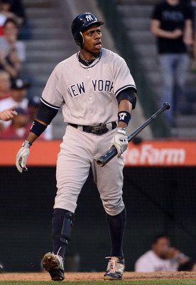 ANAHEIM, CA - MAY 29:  Curtis Granderson #14 of the New York Yankees reacts to his strikeout during the third inning against the Los Angeles Angels at Angel Stadium of Anaheim on May 29, 2012 in Anaheim, California.  (Photo by Harry How/Getty Images)