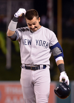 ANAHEIM, CA - MAY 29:  Nick Swisher #33 of the New York Yankees reacts to his fly ball caught for an out by Peter Bourjos #25 of the Los Angeles Angels on the warning track to end the eighth inning at Angel Stadium of Anaheim on May 29, 2012 in Anaheim, C