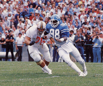 http://siphotos.tumblr.com/post/19237296146/north-carolina-linebacker-lawrence-taylor-rushes