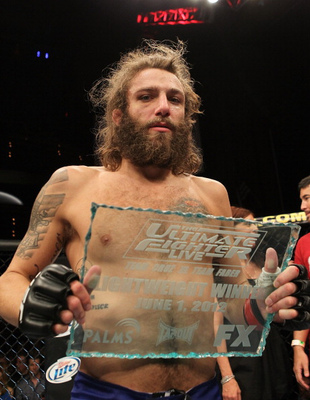 LAS VEGAS, NV - JUNE 01: Michael Chiesa holding the Ultimate Fighter trophy during The Ultimate Fighter Live Finale at the Pearl Theater at the Palms Casino Resort on June 1, 2012 in Las Vegas, Nevada. (Photo by Josh Hedges/Zuffa LLC/Zuffa LLC via Getty Images)