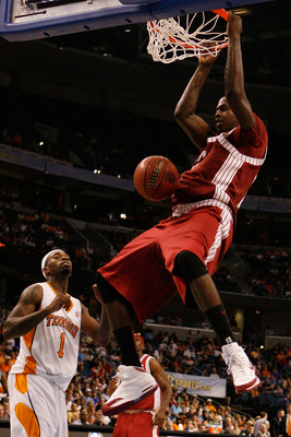 TAMPA, FL - MARCH 13:  Jamychal Green #32 of the Alabama Crimson Tide dunks the ball over Tyler Smith #1 of the Tennessee Volunteers during the quaterfinal round of the SEC Men's Basketball Tournament on March 13, 2009 at The St. Pete Times Forum in Tampa