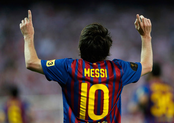MADRID, SPAIN - MAY 25:  Lionel Messi of Barcelona celebrates after scoring Barcelona's second goal during the Copa del Rey Final match between Athletic Bilbao and Barcelona at Vicente Calderon Stadium on May 25, 2012 in Madrid, Spain.  (Photo by Angel Ma