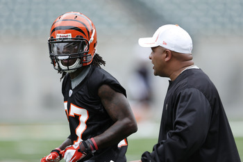 CINCINNATI, OH - MAY 12: Dre Kirkpatrick #27 of the Cincinnati Bengals talks with coach Hue Jackson during a rookie minicamp at Paul Brown Stadium on May 12, 2012 in Cincinnati, Ohio. (Photo by Joe Robbins/Getty Images)