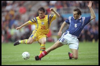 10 Jun 1996:  Laurent Blanc of France (right) attemps to tackle Viorel Moldovan of Romania during the European soccer championship match between France and Romania at St. James'' Park, Newcastle.  The match was won by France 1-0.Mandatory Credit: Clive Br
