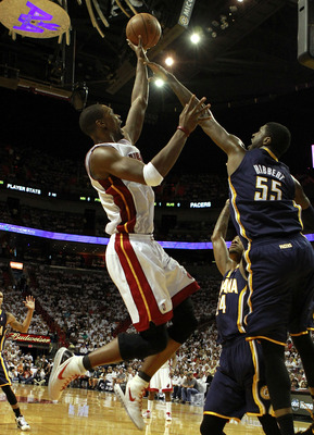 MIAMI, FL - MAY 13:  Forward Chris Bosh #1 of the Miami Heat shoots against Center Roy Hibbert #55 (R) of the Indiana Pacers in Game One of the Eastern Conference Semifinals in the 2012 NBA Playoffs on May 13, 2012 at the American Airines Arena in Miami,