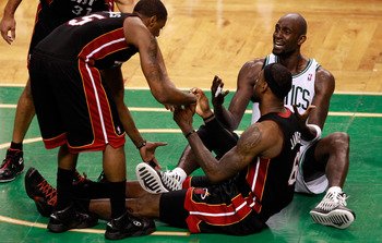 BOSTON, MA - JUNE 03:  Kevin Garnett #5 of the Boston Celtics reacts as Mario Chalmers #15 of the Miami Heat helps up teammates LeBron James #6 in Game Four of the Eastern Conference Finals in the 2012 NBA Playoffs on June 3, 2012 at TD Garden in Boston,