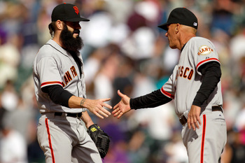 DENVER, CO - APRIL 12:  Brian Wilson #38 of the San Francisco Giants shakes hands with third base coach Tim Flannery of the San Francisco Giants after defeating the Colorado Rockies 4-2 at Coors Field on April 12, 2012 in Denver, Colorado.  (Photo by Just