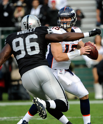 Wimbley bears down on Broncos quarterback Tim Tebow. He had 6 tackles and a sack versus Denver.