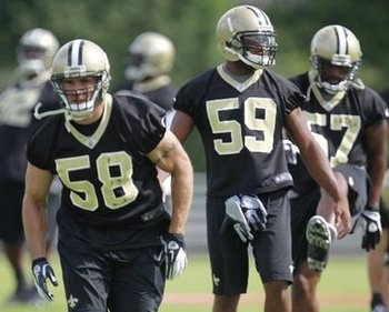 David Hawthorne (R) works with members of the Saints LB corps during OTAs (photo courtesy of The Times-Picayune).