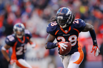 DENVER, CO - JANUARY 08:  Quinton Carter #28 of the Denver Broncos runs with the ball against the Pittsburgh Steelers during the AFC Wild Card Playoff game at Sports Authority Field at Mile High on January 8, 2012 in Denver, Colorado.  (Photo by Doug Pens