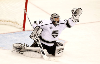 NEWARK, NJ - JUNE 02: Jonathan Quick #32 of the Los Angeles Kings makes a glove save against the New Jersey Devils during Game Two of the 2012 NHL Stanley Cup Final at the Prudential Center on June 2, 2012 in Newark, New Jersey.  (Photo by Paul Bereswill/
