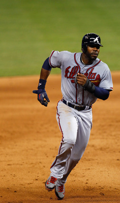 MIAMI, FL - JUNE 05:  Jason Heyward #22 of the Atlanta Braves rounds second base during a game against the Miami Marlins at Marlins Park on June 5, 2012 in Miami, Florida.  (Photo by Sarah Glenn/Getty Images)