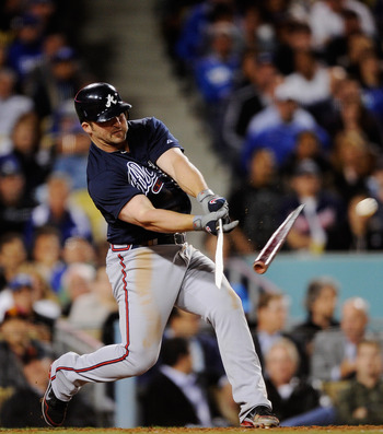 LOS ANGELES, CA - APRIL 23:  Dan Uggla #26 of the Atlanta Braves breaks his bat as he hits a single during the fifth inning against the Los Angeles Dodgers at Dodger Stadium on April 23, 2012 in Los Angeles, California.  (Photo by Kevork Djansezian/Getty
