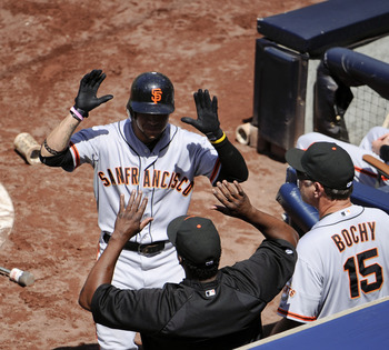 Gregor Blanco hi-fives a teammate after his home run in San Francisco's 8-3 win over San Diego.
