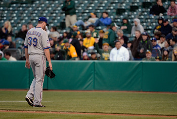 Rangers' starter Scott Feldman walks off the mound after a start against the A's.