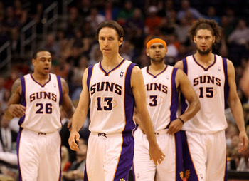 PHOENIX, AZ - MARCH 12:  Steve Nash #13 of the Phoenix Suns walks up court with teammates during the NBA game against the Minnesota Timberwolves at US Airways Center on March 12, 2012 in Phoenix, Arizona. The  Timberwolves defeated the Suns 127-124.  NOTE