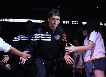 PHOENIX, AZ - APRIL 25:  Steve Nash #13 of the Phoenix Suns high fives fans as he is introduced before the NBA game against the San Antonio Spurs at US Airways Center on April 25, 2012 in Phoenix, Arizona.  The Spurs defeated the Suns 110-106.  NOTE TO US