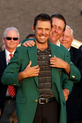 Charl Schwartzel accepts the Green Jacket from Phil Mickelson